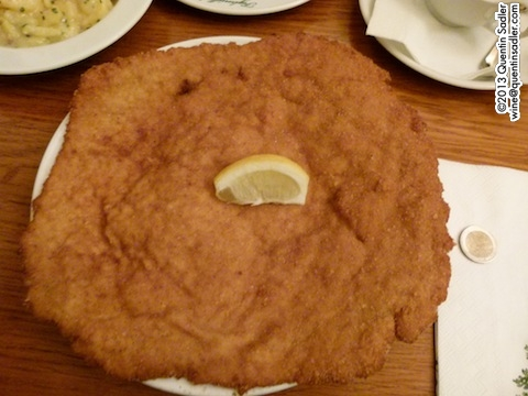 Wiener Schnitzel at Figlmüller with a €2 piece for comparison.