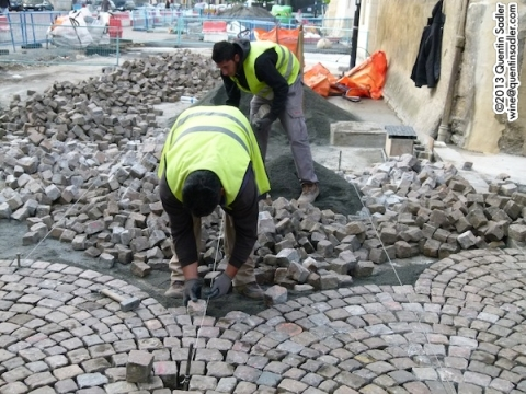 Repairing the cobble stones.