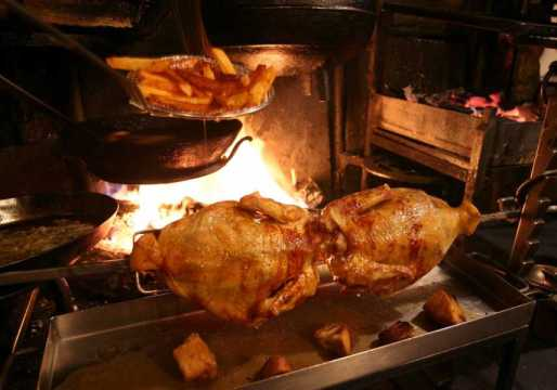 Spit roast chicken being cooked at la Tupina - photo courtesy of La Tupina.