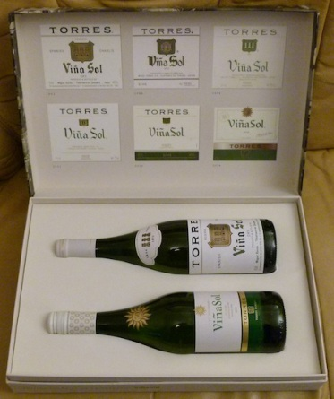 The box containing 2 bottles of Viña Sol & decorated with replicas of Viña Sol labels through the ages.