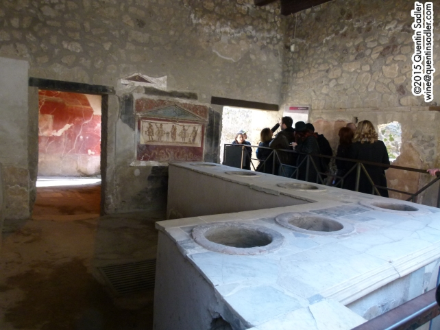 A restaurant in Pompeii, busy, but a little understaffed.
