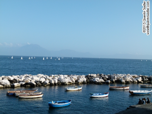 Naples fishing harbour with Capri in the background.