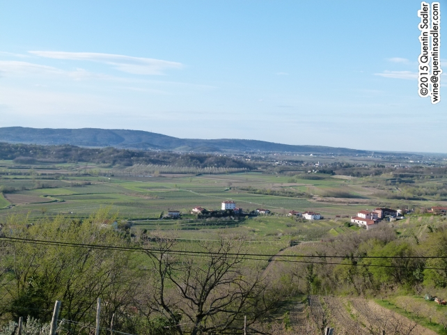 The view from the Belica Hotel. The building in the middle distance on the right is Movia. In the middle of the photo is a white building with a small road in front of it. That road marks the frontier.